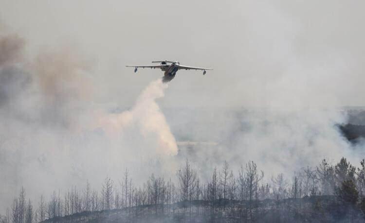 <p>BODRUM'DA BÜYÜK KORKU</p>  <p>Yangın, rüzgarın etkisiyle yangın kısa sürede geniş alana yayıldı. Bölgeye çok sayıda itfaiye ekibi sevk edildi. Alevlerin yaklaşık 150 metre uzaklıktaki yerleşim alanına sıçramaması için yoğun çalışma yürütüldü.</p>