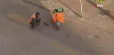 Bolu'da temizlik işçisi yanına gelen kargayı elleriyle besledi