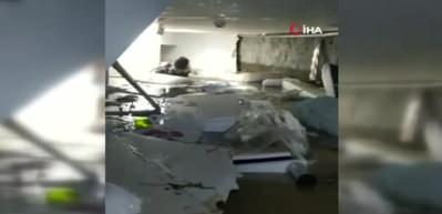 Su basan mağazanın bodrumundaki kadını dalgıç polis kurtardı