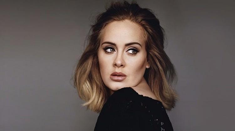 Adele: Twitter'a girmem yasak