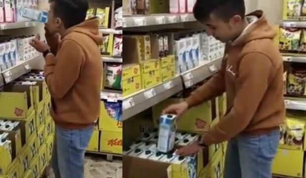 Skandal görüntü! Market raflarındaki sütleri içiyor