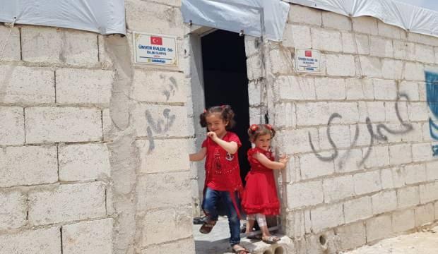 Sadakataşı İdlib'de briket ev açılışlarını sürdürüyor