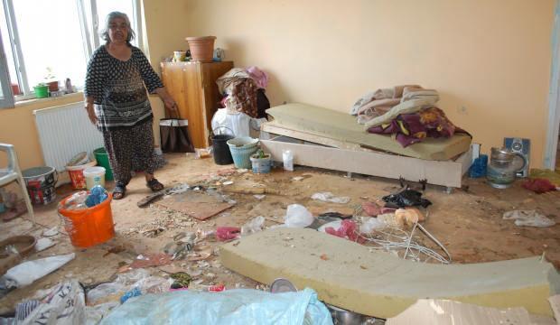 Evi çöplüğe dönen kadın hüngür hüngür ağladı