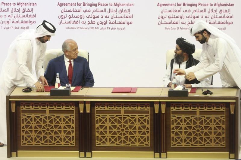 Daha önce Katar'ın başkenti Doha'da yapılan görüşmeden bir kare...