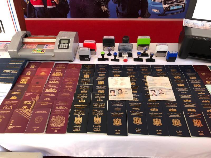 Sahte pasaport düzenleyen şebekeye operasyon düzenlendi.