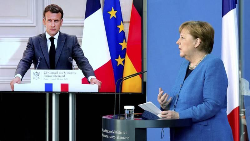 Merkel ve Macron'un düzenlediği ortak basın toplantısından bir kare