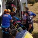Kayalıklara düşen yamaç paraşütçüsü yaralandı