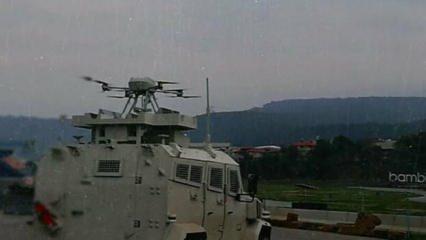 Bir ilk gerçekleştirildi: Silahlı drone askeri kara aracına entegre edildi